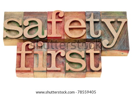 safety first - isolated phrase in vintage wood letterpress printing blocks
