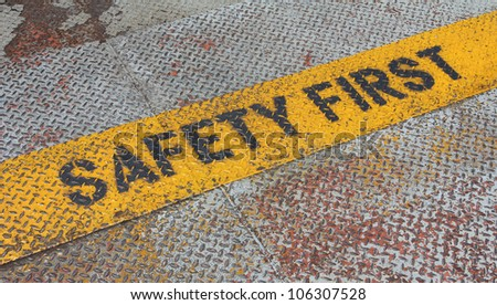 Safety First Sign on caution strip.