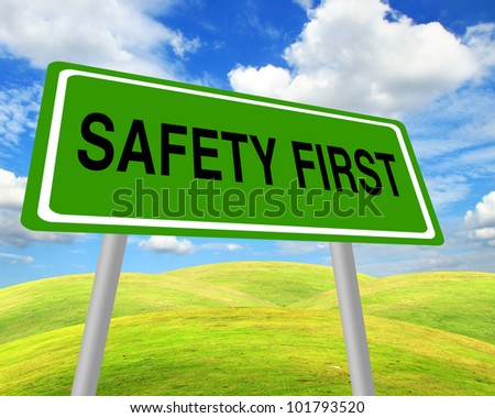 Safety first sign over environment field - stock photo