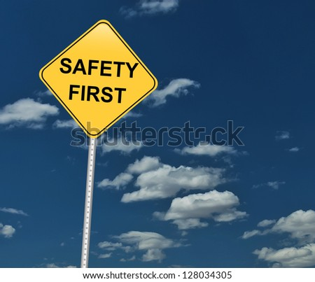 safety first traffic sign on blue sky