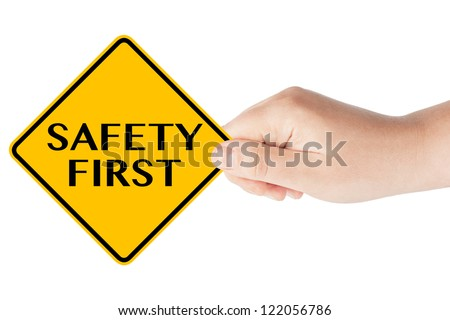 Safety First traffic sign with hand on the white background