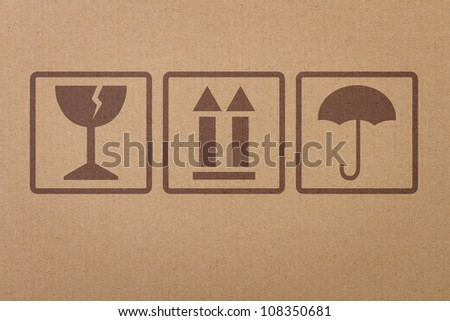 Safety, fragile icons on a cardboard parcel