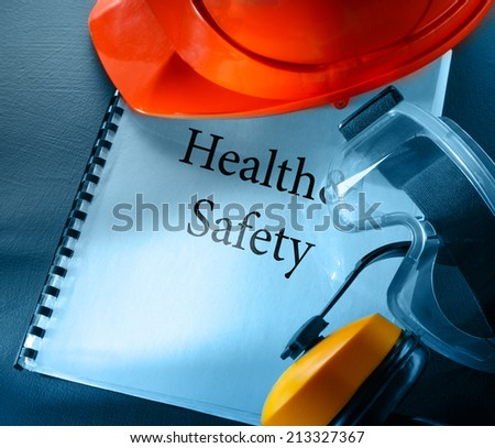 Safety goggles, earphones and red helmet - Shutterstock ID 213327367