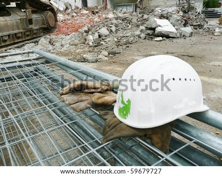 Safety helmet and gloves on the construction site