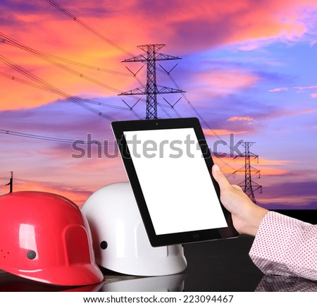 safety helmet on civil engineer working table against electical tower