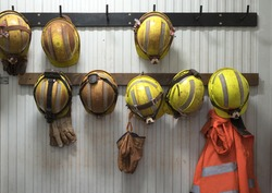 Safety helmets and gloves hang rack at construction site