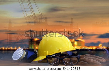 Safety in Refinery Concept , safety standard set  on working table, Background power plant , heavy petrochemical industry estate use for energy , power , fuel ,gas and fossil petroleum topic. #541490515