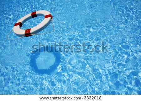 Safety lifebelt floating in bright blue water