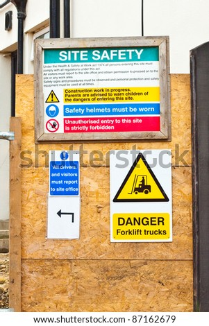 Safety notices at a construction site in the UK - stock photo
