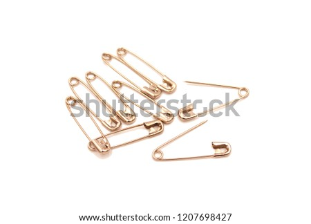 Safety pin isolated on white background #1207698427