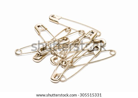 Safety pin isolated on white background.  #305515331