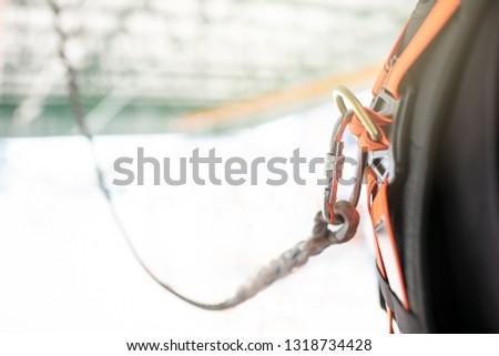 safety protective equipment loop in his back of Industrial Worker with the rope hanging with the reel #1318734428