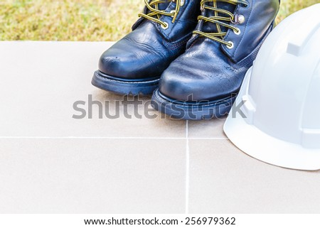 safety shoe and safety helmet on Brown Background