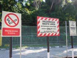 Safety signage for hazardous chemical and hazardous waste storage in bilingual language, Malay & English.