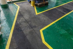 Safety walkway on ships deck. Yellow black anti-slip safety walkway  for ships crew and contractors. Passengers or contractors footpath on board offshore vessel.