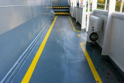 Safety walkway on ships deck. Yellow line walkway. Guided walkway on board. Passenger / contractor footpath on board offshore vessel.