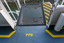 Safety walkway on ships deck. Yellow line walkway. Guided walkway on board. Passenger / contractor footpath on board offshore vessel. Stairs on board ship. PPE area.