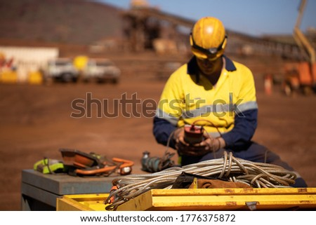 Safety workplace clear picture of power cord defocused trained competent electrician setting holding red electricity tester, conducting safety testing inspecting tagging light prior used background  Сток-фото ©