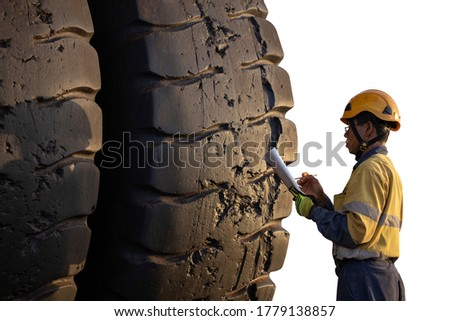 Safety workplace pre operation checklist motor vehicle mechanic inspector wearing safety helmet standing inspecting writing defect of damage haul track tire prior work clipping path white background   Imagine de stoc ©