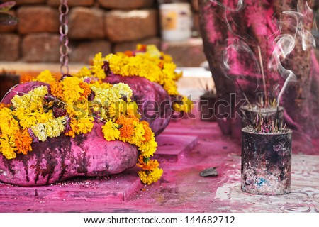 Saffron flower garlands and incense near Arambol temple Goa India