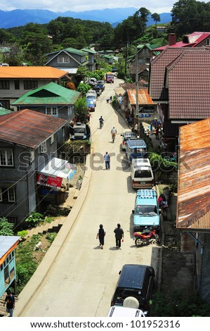 "SAGADA, PHILIPPINES - MARCH 27: Aerial view on the street on March 27, 2012 in Sagada, Philippines. Sagada - is located 275 km from Manila. It is famous tourist destinations for its ""hanging coffins"""