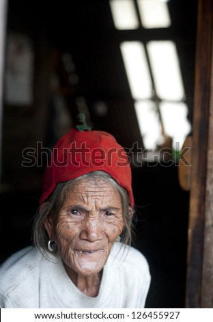 SAGADA, PHILIPPINES - MARCH 29: Portrait of an unidentified old Philippines woman on March 29, 2012 in Sagada, Philippines.  Philippines has a population of more than 92 million people.