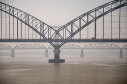 Sagaing, Myanmar - Early morning scene on the Irrawaddy river. Low angle view to both the new and the old Ava bridges.