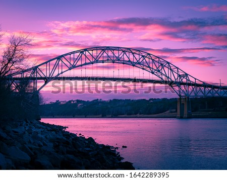 Sagamore Bridge over the Cape Cod Canal under a purple twilight sky