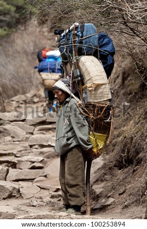 SAGARMATHA NATIONAL PARK, NEPAL - MARCH 06: Porters carry heavy load in the Himalaya in time of Russian expedition on March 06, 2010 in Sagarmatha National Park, Nepal