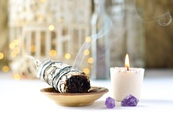 sage candle with amethyst and twinkle lights