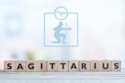 Sagittarius star sign on a wooden table