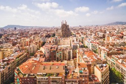 Sagrada Familia cathedral and Barcelona cityscape in Spain, aerial view.