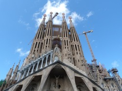 Sagrada Familia Cathedral by Gaudi in Spain Barcelona 2014 bottom view on the blue sky background