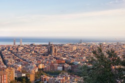 Sagrada Familia dominates the panorama of Barcelona from the top of the hill
