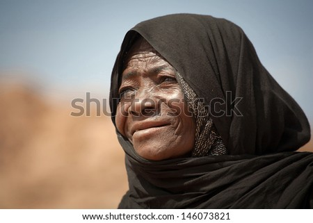 SAHARA DESERT, DJANET, ALGERIA, MAR 01: Tuareg woman in the Sahara desert, Djanet, Algeria, March 01, 2011. Nomadic tribes living in the desert, and a traditional lifestyle as a hundred years ago.