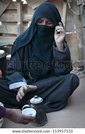 SAHARA DESERT, EGYPT - YAN 26: Portrait of the unknown old berber woman in the Sahara Desert, Egupt, Yanuary 26, 2010. Tribes of bereber wander across all North Africa from Morocco to Egypt.