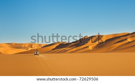 Sahara Desert Safari - Off-road vehicle driving in the Awbari Sand Sea, Libya