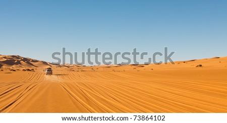 Sahara Desert Safari - Off-road vehicles driving in the Awbari Sand Sea, Libya
