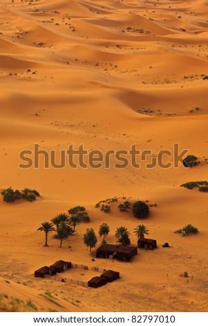 Sahara, Morocco: Aerial view of Sahara desert sand dunes and Bedouin camp, Morocco