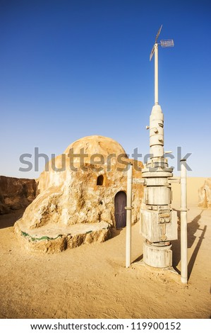 SAHARA, TUNISIA - JUL 10: Abandoned sets for the shooting of the movie Star Wars in the Sahara desert on a background of sand dunes on July 10, 2012 in Sahara, Tunisia