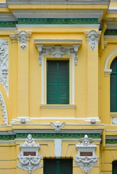 Saigon Central Post Office. Detail of the facade with the names of French scientists Chappe and Ampere on it