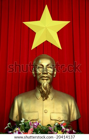 SAIGON - 14 NOV: Bust of the Vietnamese communist leader Ho Chi Minh in front of the national flag in Saigon, picture taken on 14 November 2007