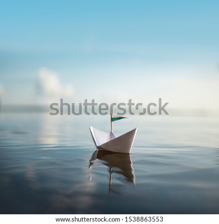 Sail away - Paper Boat on the ocean