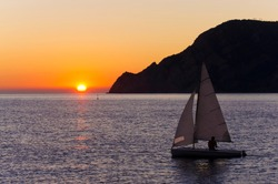 sail boat at sunset on the sea. Cinque Terre, Italy