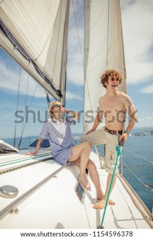 Sail boat during sunny summer weather on calm blue sea water with romantic couple on the deck. Luxury summer adventure, active vacation in Mediterranean sea. #1154596378