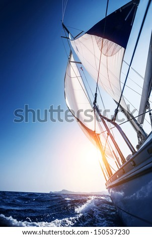 Sail boat in action summer adventure luxury water transport sunset light active lifestyle recreation in the sea travel and tourism concept