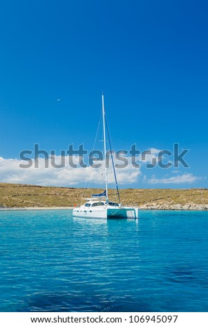 Sail Boat in Tropical Blue Ocean