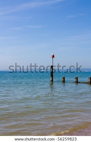 Sail boat off Bournemouth beach, Dorset on the English south coast in summer.