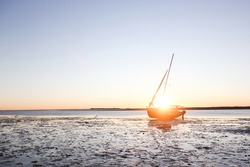 Sail Boat On Dry Lake Bed At Sunset In New Zealand