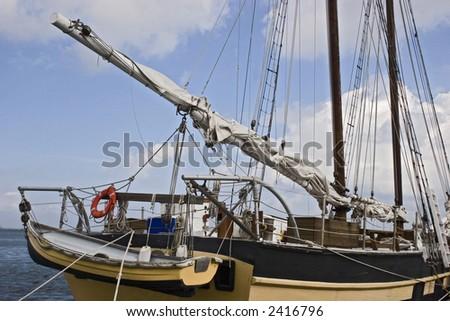 Sail Boat Tied Up At Pier